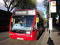 London United OV18 on Route 391, Turnham Green Church (14023787295).jpg