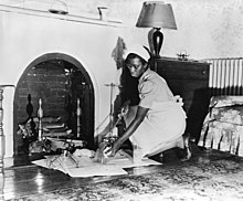 Maid cleaning fireplace fsa 8e04227.jpg