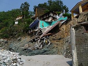 2013 North India floods - Broken end of footbridge over the Mandakini River at Rudraprayag Sangam.