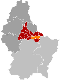 Map of Luxembourg with Ermsdorf highlighted in orange, the district in dark grey, and the canton in dark red