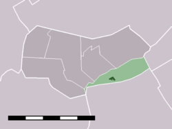 The town centre (dark green) and the statistical district (light green) of Zwaagdijk-West in the municipality of Wognum.