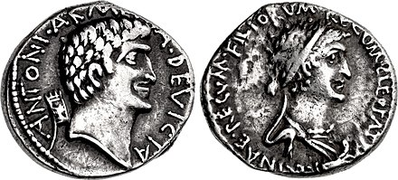 "A denarius minted by Antony in 34 BC with his portrait on the obverse, which bears the inscription reading ""ANTONIVS ARMENIA DEVICTA"", alluding to his Armenian campaign. The reverse features Cleopatra, with the inscription ""CLEOPATR[AE] REGINAE REGVM FILIORVM REGVM"". The mention of her children on the reverse refers to the Donations of Alexandria. Mark Antony & Cleopatra, denarius, 34 BC, 543-1.jpg"