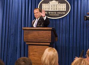 Scott McClellan - McClellan waves farewell following his final press conference, May 5, 2006.