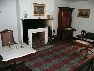 Battle of Appomattox Court House - Parlor of the (reconstructed) McLean House, the site of Confederate General Robert E. Lee's surrender. Lee sat at the marble-topped table on the left, Lieutenant General Ulysses S. Grant at the table on the right