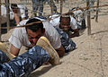 Members of Iraqi Police and Border Patrol crawl under barbed wire while running an obstacle course at the Police Academy in Basrah, Iraq, May 4, 2011 110504-A-YD132-328.jpg