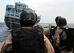 Members of the visit, board, search and seizure team aboard guided-missile cruiser USS Anzio (CG 68) approach a dhow and prepare to question its sailors Aug. 30, 3009, in the Gulf of Aden 090830-N-ZL677-006.jpg