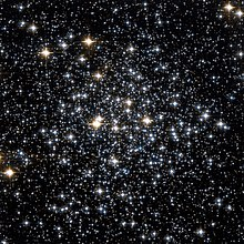 Several hundred stars of different brightnesses and colours scattered on a black background