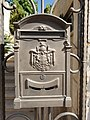 Metal mailbox on the entrance gate of a house.jpg