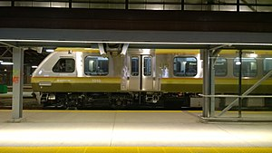 Metrolinx - Photograph of one of the Metrolinx Union-Pearson Express trains sitting by platform 24 of Toronto Union Station.