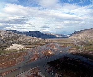 Borden Peninsula - Mid-Borden Peninsula. Erosion of Proterozoic redbeds throws iron stain into Mala River sediments.