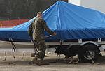 Military working dogs sink their teeth in explosive, drugs detection training 121205-M-RB277-005.jpg