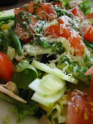 The closeup of a salad. Ingredients include le...