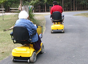 Scooter  Mobility on Two People Using Mobility Scooters At A Zoo