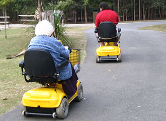 Mobility scooter - Two people using mobility scooters