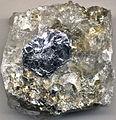 Molybdenite in quartz-rich pegmatitic granite (Abitibi Greenstone Belt, Precambrian; Moly Hill Mine, Quebec, Canada) 2 (19236032102).jpg