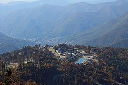 General view of the Krasnaya Polyana from the Psekhako Ridge. In the foreground is a mountain Olympic village.
