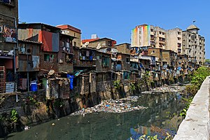 Urbanisation in India - Crowded housing and polluted waterway in Mumbai