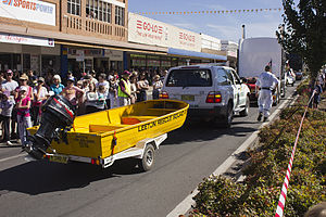 NSWVRA vehicle and boat in the SunRice Festival parade in Pine Ave.jpg