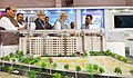 "Narendra Modi visiting an exhibition on Flagship Missions of Urban Development during the event ""Transforming Urban Landscape Third Anniversary of Pradhan Mantri Awas Yojana (Urban) (2).JPG"