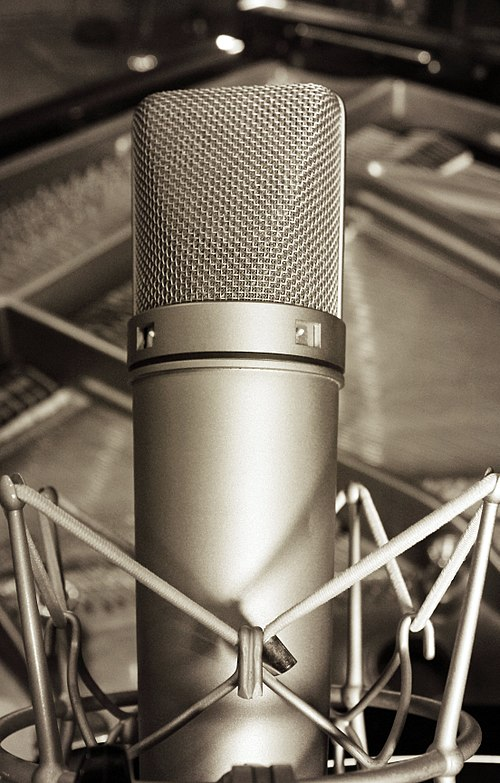 Neumann U87 Condenser Microphone on the piano - Studio A, In Your Ear Studios (cropped).jpg
