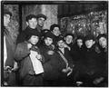 Newsies in cellar-room of a paper office in alley back of Main St. waiting for evening papers, 4 P.M. Conditions here... - NARA - 523276.tif