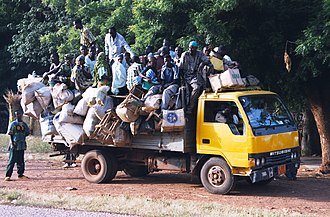 Seasonal migration in Niger - A truck, like many seen on West Africa roads, picks up travelers along a road in southwest Niger.