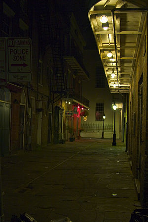Urban Gothic - A dark alley in the French Quarter of New Orleans at night, part of the distinctive architecture that made it the centre of Gothic novels by authors including Anne Rice and Poppy Z. Brite