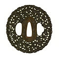 Noda Mitsuhiro II - Tsuba with One Hundred Monkeys - Walters 51112.jpg
