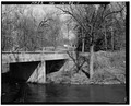 North abutment, looking northwest - Pendleton Avenue Bridge, Spanning Fall Creek, Pendleton, Madison County, IN HAER IND,48-PEN,1-11.tif