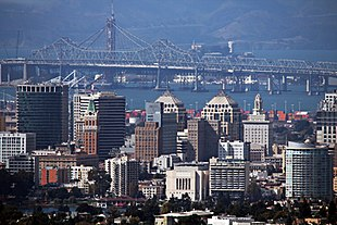 """Oakland skyline, with the old eastern span of the <a href=""""http://search.lycos.com/web/?_z=0&q=%22San%20Francisco%E2%80%93Oakland%20Bay%20Bridge%22"""">San Francisco–Oakland Bay Bridge</a> in background"""