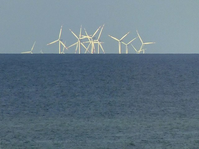 Off-shore windmills disappearing behind the curvature of the Earth
