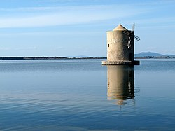 The windmill on the lagoon of Orbetello.