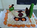 Os vehicle made out of capsicum, carrot, beet & cucumber.jpg