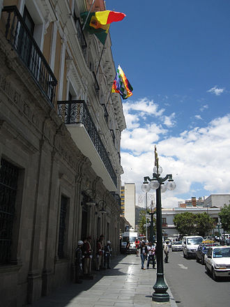 Flag of Bolivia - The Wiphala and the tricolor flying on the presidential Palacio Quemado in La Paz.