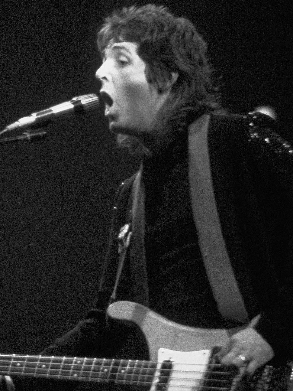 Paul McCartney during a Wings concert, 1976 (34 cropped)