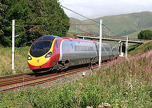 British Rail Class 390 - Class 390 Pendolino at Beck Foot A southbound Pendolino speeds through the Eden Valley in the Lake District.