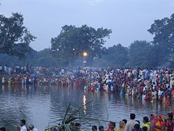 People Celebrating Chhath on 2nd Day Morning Around the Pond.jpg