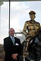 Philip Weyers with statue of his great grandfather.jpg
