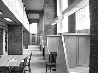 Phillips Exeter Academy Library -  The outer part of the building, which houses the carrels, is built of load-bearing brick. Each carrel floor spans two levels of book stacks.