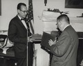 Photograph of Dr. James B. Rhoads Presenting Book of Tributes to Dr. Grover at His Retirement Party, 1965.tif