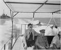 "Photograph of Fleet Admiral William Leahy, President Truman, and others on board the ""Big Wheel,"" a boat transporting... - NARA - 200590.tif"