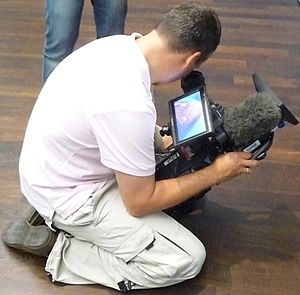 English: Videographer not taking a photo in a ...