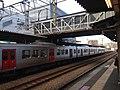 Platform and overpass of Kashii Station with train of Kagoshima Main Line bounding for Fukuma Station 20150113 160356.jpg