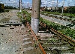 Poles inside rail lines.jpg