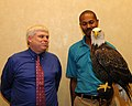 Posing for picture with Bald Eagle. (10594672626).jpg