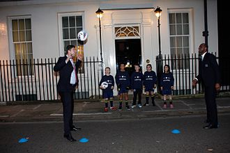 Niall Quinn - Quinn and Patrick Vieira participate in a game of headers at 11 Downing Street, while schoolchildren from Gillespie Primary School look on, 2011