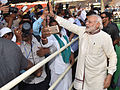 Prime Minister Narendra Modi interacts with people at Panchayati Raj Sammelan.jpg