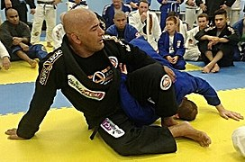Professor Ailson 'Jucao' Brites Demonstrating an Omoplata Variation.jpg