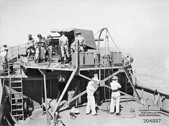QF 4 inch naval gun Mk IV, XII, XXII - Image: QF 4 inch Mk IV gun recoiling on HMAS Wilcannia AWM 304887