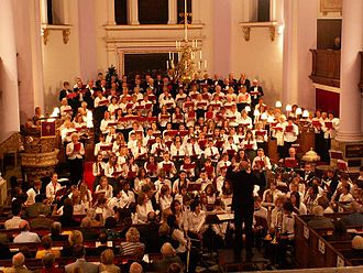 """Queen Elizabeth's High School - Members of Queen Elizabeth's High School and Gainsborough Choral Society perform in an annual Christmas carol concert, """"Carols for All."""" Phillip Ainsworth (previous Head of Music) conducts."""